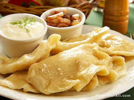 Polish pierogies filled stuffed with cheese and potatoes with cream and bacon